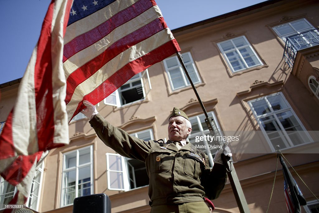 A history enthusiast dressed in WWII US army uniform holds the flag of USA during the ''Convoy of Liberty'' event on April 26, 2013 in Prague, Czech Republic. 'Convoy of Liberty' commemorates when in 1945 the western part of the Czech Republic was liberated by the US Army from Nazi oppression. The convoy's route begins in Prague tomorrow and makes its first stop in front of the US Embassy, where it will be met by the Czech Army Military Band.