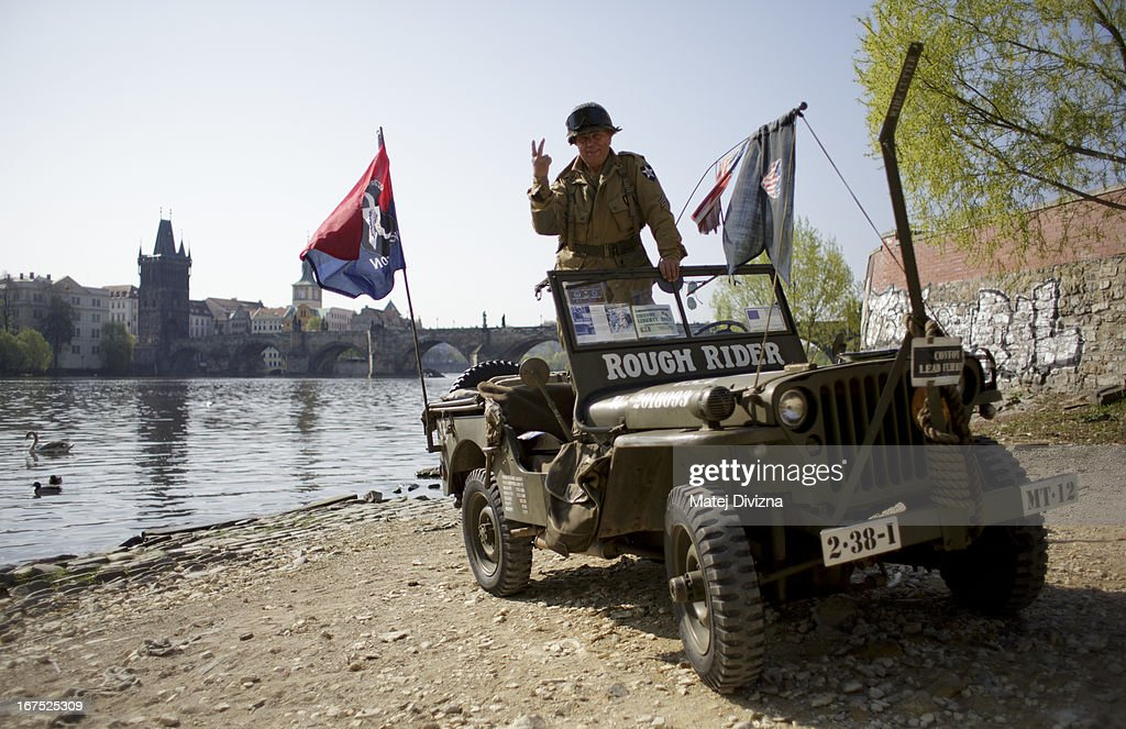A history enthusiast dressed in WWII US army uniform poses during the ''Convoy of Liberty'' event on April 26, 2013 in Prague, Czech Republic. 'Convoy of Liberty' commemorates when in 1945 the western part of the Czech Republic was liberated by the US Army from Nazi oppression. The convoy's route begins in Prague tomorrow and makes its first stop in front of the US Embassy, where it will be met by the Czech Army Military Band.