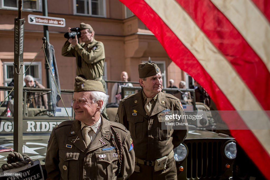 History enthusiasts dressed in WWII US army uniform attend the 'Convoy of Liberty' event on April 29, 2016 in Prague, Czech Republic. The 'Convoy of Liberty' commemorates the 71st anniversarry of the liberation of the western part of the Czech Republic by the US Army from Nazi oppression in 1945. The convoy's route begins on the bank of Vltava river in Prague and makes its first stop in front of the US Embassy, where it will be met by the Czech Army Military Band.