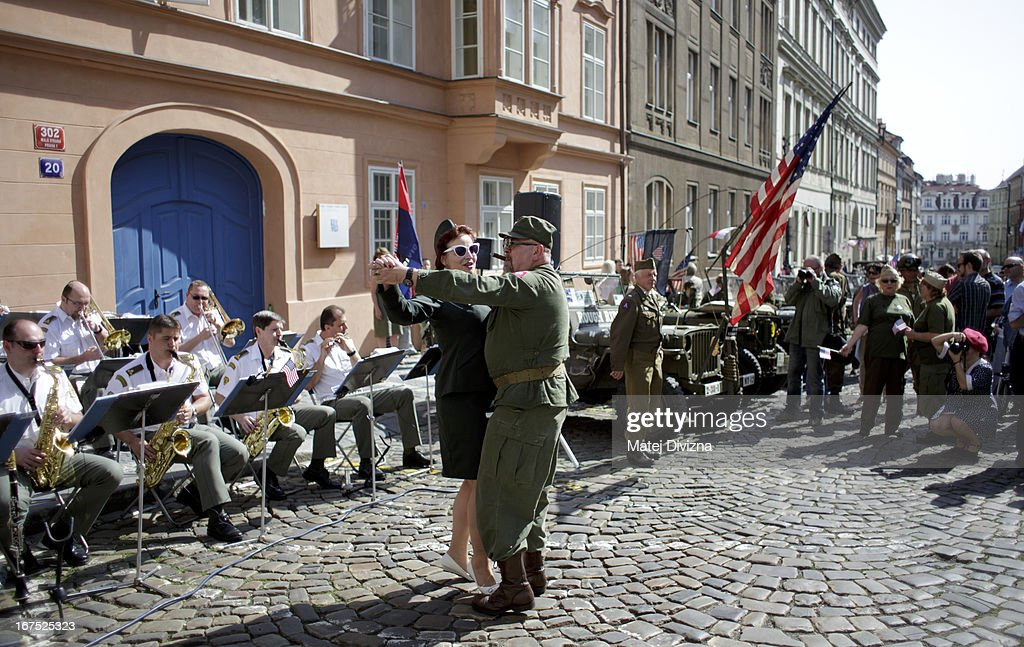 History enthusiasts dressed in WWII US army uniform dance during the ''Convoy of Liberty'' event on April 26, 2013 in Prague, Czech Republic. 'Convoy of Liberty' commemorates when in 1945 the western part of the Czech Republic was liberated by the US Army from Nazi oppression. The convoy's route begins in Prague tomorrow and makes its first stop in front of the US Embassy, where it will be met by the Czech Army Military Band.