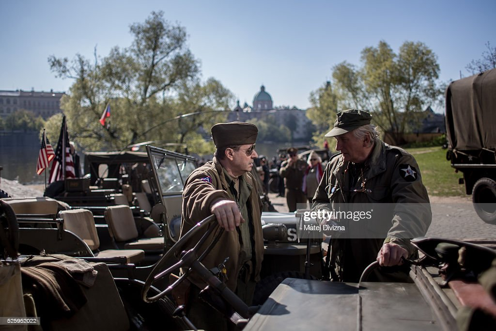 History enthusiasts dressed in WWII US army uniform talk to each other as they wait for the 'Convoy of Liberty' event on April 29, 2016 in Prague, Czech Republic. The 'Convoy of Liberty' commemorates the 71st anniversarry of the liberation of the western part of the Czech Republic by the US Army from Nazi oppression in 1945. The convoy's route begins on the bank of Vltava river in Prague and makes its first stop in front of the US Embassy, where it will be met by the Czech Army Military Band.