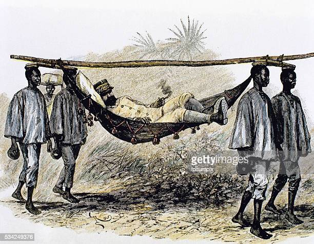 History of Africa Colonialism 19th century European colonizer carried in a hammock by four African porters Colored engraving
