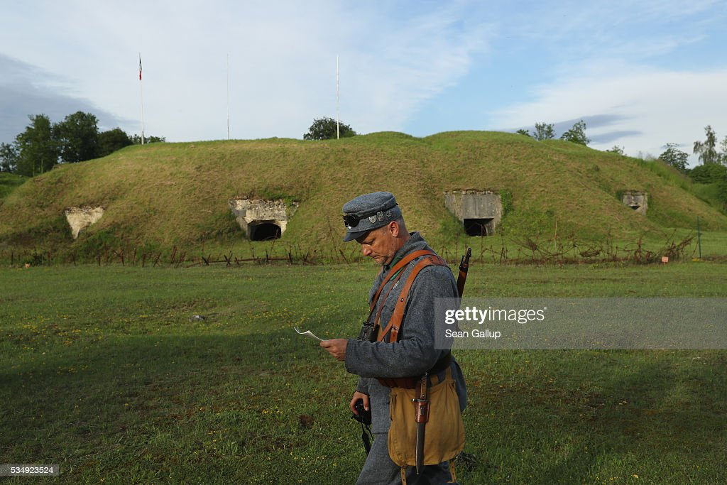 A history reenactor dressed as a World War I Austro-Hungarian soldier walks among the ruins of Fort de Troyon, a labyrinthine fortress built into a hilltop and one of the many forts used by the French to defend the region around Verdun during World War I, on May 28, 2016 near Verdun, France. The governments of France and Germany will commemorate the 100th anniversary of the World War I Battle of Verdun with ceremonies tomorrow. Approximately 300,000 soldiers lost their lives in the 10-month campaign that was among the most grueling battles of World War I.