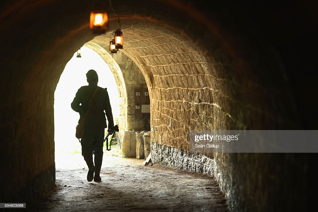 A history reenactor dressed as a World War I Austro-Hungarian soldier walks inside the labyrinthine ruins of Fort de Troyon, a fortress built into a hilltop and one of the many forts used by the French to defend the region around Verdun during World War I, on May 28, 2016 near Verdun, France. The governments of France and Germany will commemorate the 100th anniversary of the World War I Battle of Verdun with ceremonies tomorrow. Approximately 300,000 soldiers lost their lives in the 10-month campaign that was among the most grueling battles of World War I.