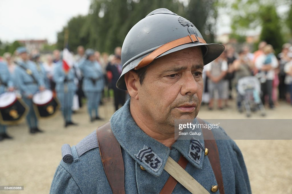 A history reenactor dressed as a World War I French soldier sings 'La Marseillaise' during a commemoration ceremony at the World War I French cemetery, where nearly 5,000 fallen soldiers lie, on May 28, 2016 in Verdun, France. The governments of France and Germany will commemorate the 100th anniversary of the World War I Battle of Verdun with ceremonies tomorrow. Approximately 300,000 soldiers lost their lives in the 10-month campaign that was among the most grueling battles of World War I.