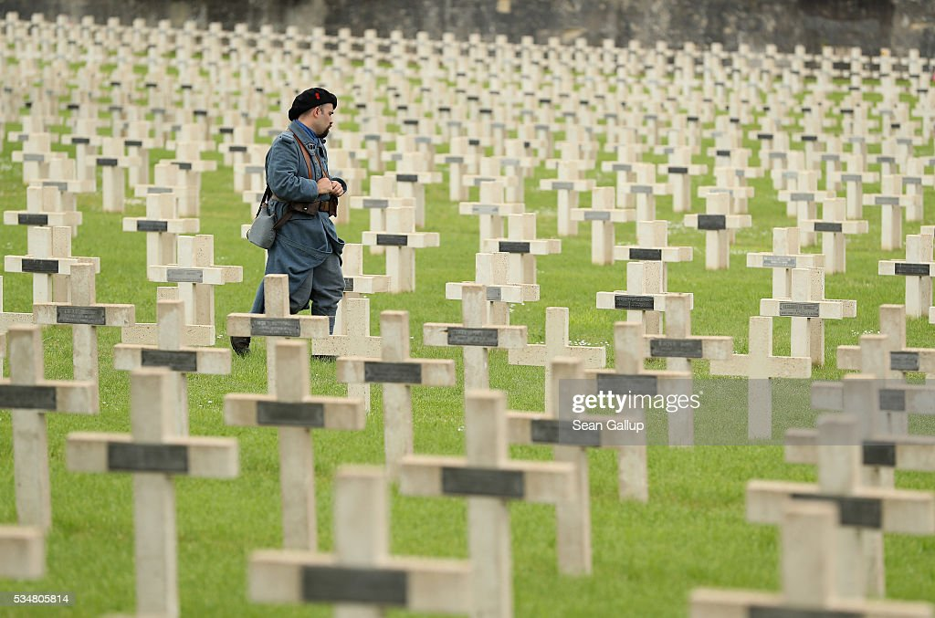 A history reenactor dressed as a World War I French soldier walks among tombstones prior to a commemoration ceremony at the World War I French cemetery, where nearly 5,000 fallen soldiers lie, on May 28, 2016 in Verdun, France. The governments of France and Germany will commemorate the 100th anniversary of the World War I Battle of Verdun with ceremonies tomorrow. Approximately 300,000 soldiers lost their lives in the 10-month campaign that was among the most grueling battles of World War I.