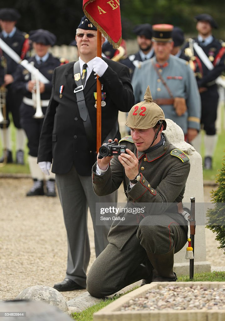 A history reenactor dressed as a World War I German soldier films with a video camera at a commemoration ceremony at the World War I French cemetery, where nearly 5,000 fallen soldiers lie, on May 28, 2016 in Verdun, France. The governments of France and Germany will commemorate the 100th anniversary of the World War I Battle of Verdun with ceremonies tomorrow. Approximately 300,000 soldiers lost their lives in the 10-month campaign that was among the most grueling battles of World War I.