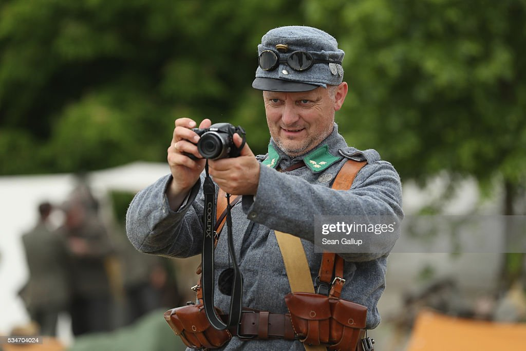 A history reenactor dressed as a World War I soldiers snaps a photo at his campsite on May 27, 2016 in Verdun, France. The governments of France and Germany will commemorate the 100th anniversary of the World War I Battle of Verdun with ceremonies this coming Sunday. Approximately 300,000 soldiers lost their lives in the 10-month campaign that was among the most grueling battles of World War I.