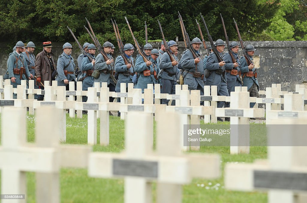 History reenactors dressed as a World War I French soldiers arrive for a commemoration ceremony at the World War I French cemetery, where nearly 5,000 fallen soldiers lie, on May 28, 2016 in Verdun, France. The governments of France and Germany will commemorate the 100th anniversary of the World War I Battle of Verdun with ceremonies tomorrow. Approximately 300,000 soldiers lost their lives in the 10-month campaign that was among the most grueling battles of World War I.