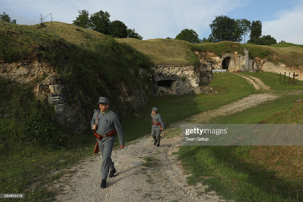 History reenactors dressed as World War I Austro-Hungarian soldiers walk among the ruins of Fort de Troyon, a labyrinthine fortress built into a hilltop and one of the many forts used by the French to defend the region around Verdun during World War I, on May 28, 2016 near Verdun, France. The governments of France and Germany will commemorate the 100th anniversary of the World War I Battle of Verdun with ceremonies tomorrow. Approximately 300,000 soldiers lost their lives in the 10-month campaign that was among the most grueling battles of World War I.