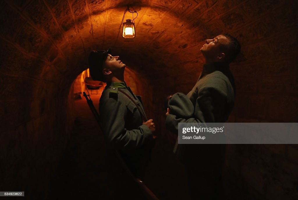 History reenactors dressed as World War I Austro-Hungarian soldiers look up into a ventilation shaft while walking inside the labyrinthine ruins of Fort de Troyon, a fortress built into a hilltop and one of the many forts used by the French to defend the region around Verdun during World War I, on May 28, 2016 near Verdun, France. The governments of France and Germany will commemorate the 100th anniversary of the World War I Battle of Verdun with ceremonies tomorrow. Approximately 300,000 soldiers lost their lives in the 10-month campaign that was among the most grueling battles of World War I.