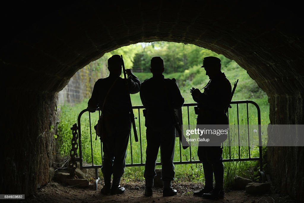 History reenactors dressed as World War I Austro-Hungarian soldiers walk inside the ruins of Fort de Troyon, a labyrinthine fortress built into a hilltop and one of the many forts used by the French to defend the region around Verdun during World War I, on May 28, 2016 near Verdun, France. The governments of France and Germany will commemorate the 100th anniversary of the World War I Battle of Verdun with ceremonies tomorrow. Approximately 300,000 soldiers lost their lives in the 10-month campaign that was among the most grueling battles of World War I.