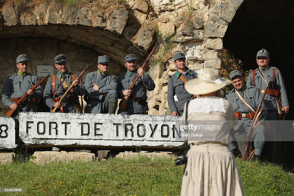 History reenactors dressed as World War I Austro-Hungarian soldiers pose for a group photo at the ruins of Fort de Troyon, a labyrinthine fortress built into a hilltop and one of the many forts used by the French to defend the region around Verdun during World War I, on May 28, 2016 near Verdun, France. The governments of France and Germany will commemorate the 100th anniversary of the World War I Battle of Verdun with ceremonies tomorrow. Approximately 300,000 soldiers lost their lives in the 10-month campaign that was among the most grueling battles of World War I.