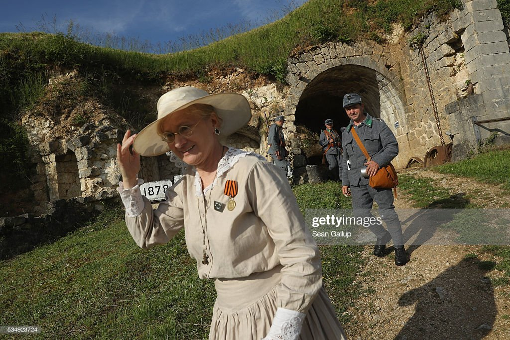History reenactors dressed as World War I Austro-Hungarian soldiers and an early 20th century lady walk among the ruins of Fort de Troyon, a labyrinthine fortress built into a hilltop and one of the many forts used by the French to defend the region around Verdun during World War I, on May 28, 2016 near Verdun, France. The governments of France and Germany will commemorate the 100th anniversary of the World War I Battle of Verdun with ceremonies tomorrow. Approximately 300,000 soldiers lost their lives in the 10-month campaign that was among the most grueling battles of World War I.