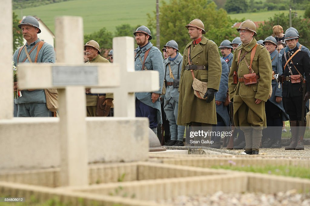 History reenactors dressed as World War I French soldiers attend a commemoration ceremony at the World War I French cemetery, where nearly 5,000 fallen soldiers lie, on May 28, 2016 in Verdun, France. The governments of France and Germany will commemorate the 100th anniversary of the World War I Battle of Verdun with ceremonies tomorrow. Approximately 300,000 soldiers lost their lives in the 10-month campaign that was among the most grueling battles of World War I.