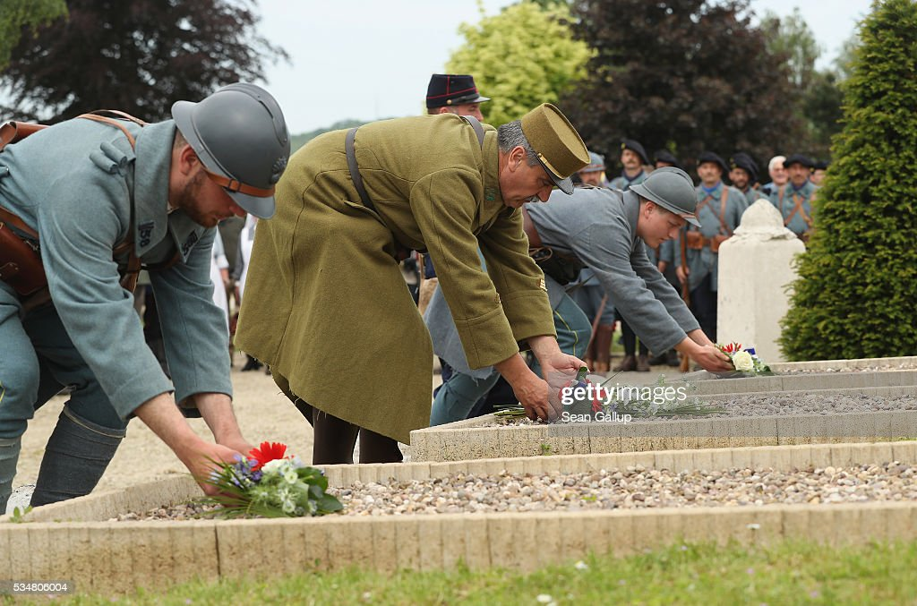 History reenactors dressed as World War I French soldiers lay flowers at tombs of unknown soldiers during a commemoration ceremony at the World War I French cemetery, where nearly 5,000 fallen soldiers lie, on May 28, 2016 in Verdun, France. The governments of France and Germany will commemorate the 100th anniversary of the World War I Battle of Verdun with ceremonies tomorrow. Approximately 300,000 soldiers lost their lives in the 10-month campaign that was among the most grueling battles of World War I.
