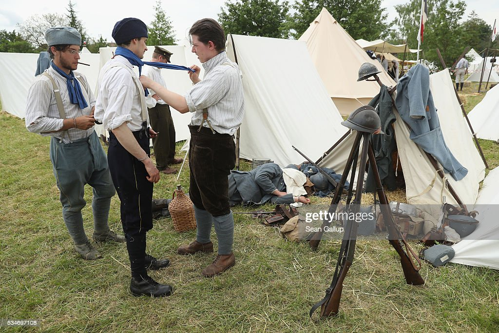 History reenactors dressed as World War I French soldiers prepare for a parade at their campsite on May 27, 2016 in Verdun, France. The governments of France and Germany will commemorate the 100th anniversary of the World War I Battle of Verdun with ceremonies this coming Sunday. Approximately 300,000 soldiers lost their lives in the 10-month campaign that was among the most grueling battles of World War I.