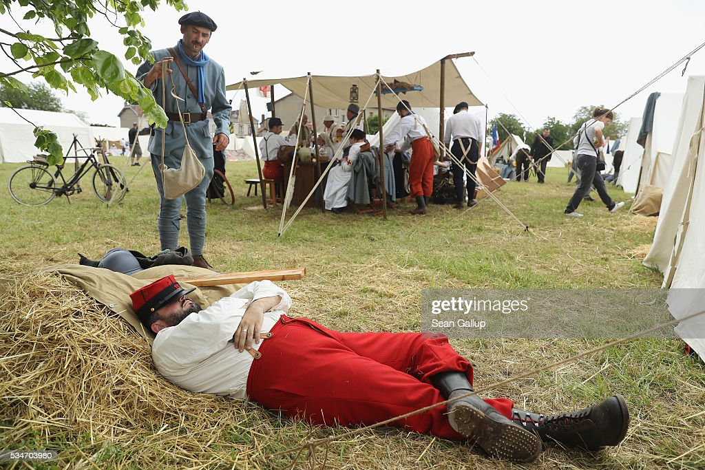History reenactors dressed as World War I French soldiers rest prior to participating in a parade at their campsite on May 27, 2016 in Verdun, France. The governments of France and Germany will commemorate the 100th anniversary of the World War I Battle of Verdun with ceremonies this coming Sunday. Approximately 300,000 soldiers lost their lives in the 10-month campaign that was among the most grueling battles of World War I.
