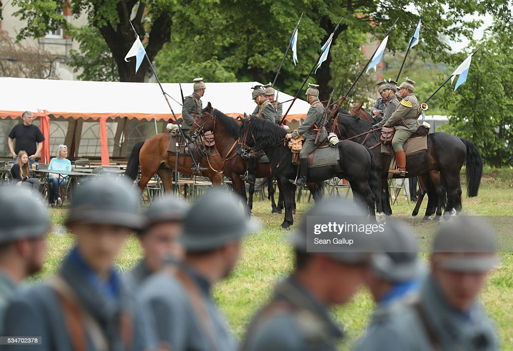 History reenactors dressed as World War I German cavalry members and on horseback as well as others as World War I French soldiers prepare to participate in a parade on May 27, 2016 in Verdun, France. The governments of France and Germany will commemorate the 100th anniversary of the World War I Battle of Verdun with ceremonies this coming Sunday. Approximately 300,000 soldiers lost their lives in the 10-month campaign that was among the most grueling battles of World War I.