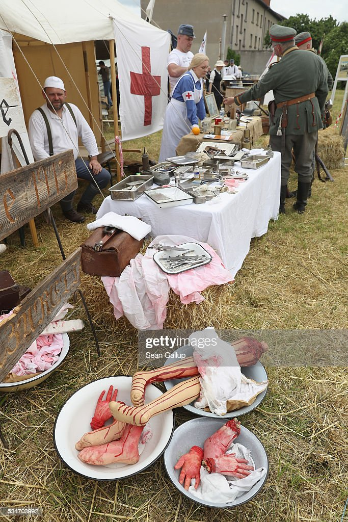 History reenactors dressed as World War I German doctors and nurses chat with others among fake body parts at their campsite on May 27, 2016 in Verdun, France. The governments of France and Germany will commemorate the 100th anniversary of the World War I Battle of Verdun with ceremonies this coming Sunday. Approximately 300,000 soldiers lost their lives in the 10-month campaign that was among the most grueling battles of World War I.