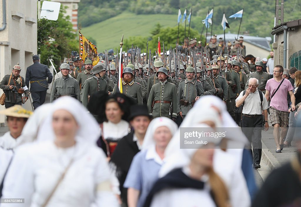 History reenactors dressed as World War I German soldiers and French nurses participate in a parade on May 27, 2016 in Verdun, France. The governments of France and Germany will commemorate the 100th anniversary of the World War I Battle of Verdun with ceremonies this coming Sunday. Approximately 300,000 soldiers lost their lives in the 10-month campaign that was among the most grueling battles of World War I.