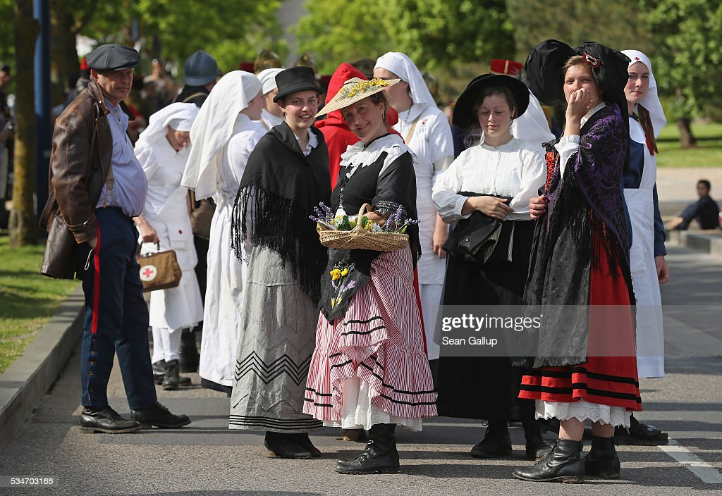History reenactors dressed as World War I nurses and wives of French alpine soldiers from Nice participate in a parade in the town center on May 27, 2016 in Verdun, France. The governments of France and Germany will commemorate the 100th anniversary of the World War I Battle of Verdun with ceremonies this coming Sunday. Approximately 300,000 soldiers lost their lives in the 10-month campaign that was among the most grueling battles of World War I.
