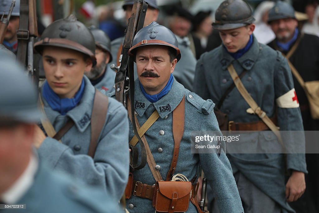 History reenactors wearing World War I French military uniforms prepare to participate in a parade on May 27, 2016 in Verdun, France. The governments of France and Germany will commemorate the 100th anniversary of the World War I Battle of Verdun with ceremonies this coming Sunday. Approximately 300,000 soldiers lost their lives in the 10-month campaign that was among the most grueling battles of World War I.