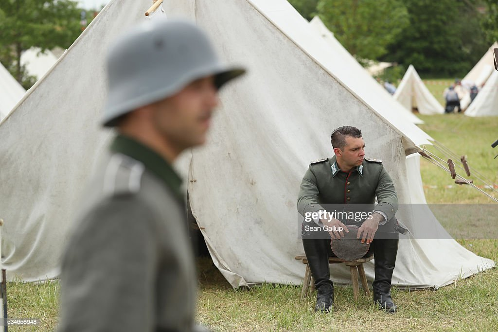 History reenactors wearing World War I German military uniforms rest at their campsite prior to a parade on May 27, 2016 in Verdun, France. The governments of France and Germany will commemorate the 100th anniversary of the World War I Battle of Verdun with ceremonies this coming Sunday. Approximately 300,000 soldiers lost their lives in the 10-month campaign that was among the most grueling battles of World War I.