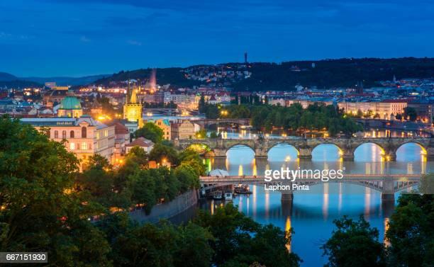 histric Prague bridges and Vltava river at twilight