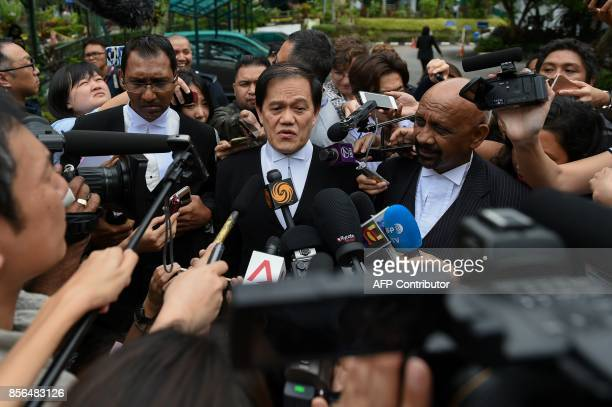 Hisyam Teh Toh Teik Salim Bashir and Naran Singh lawyers for Vietnamese woman Doan Thi Huong speak to journalists during a break in the trial for...