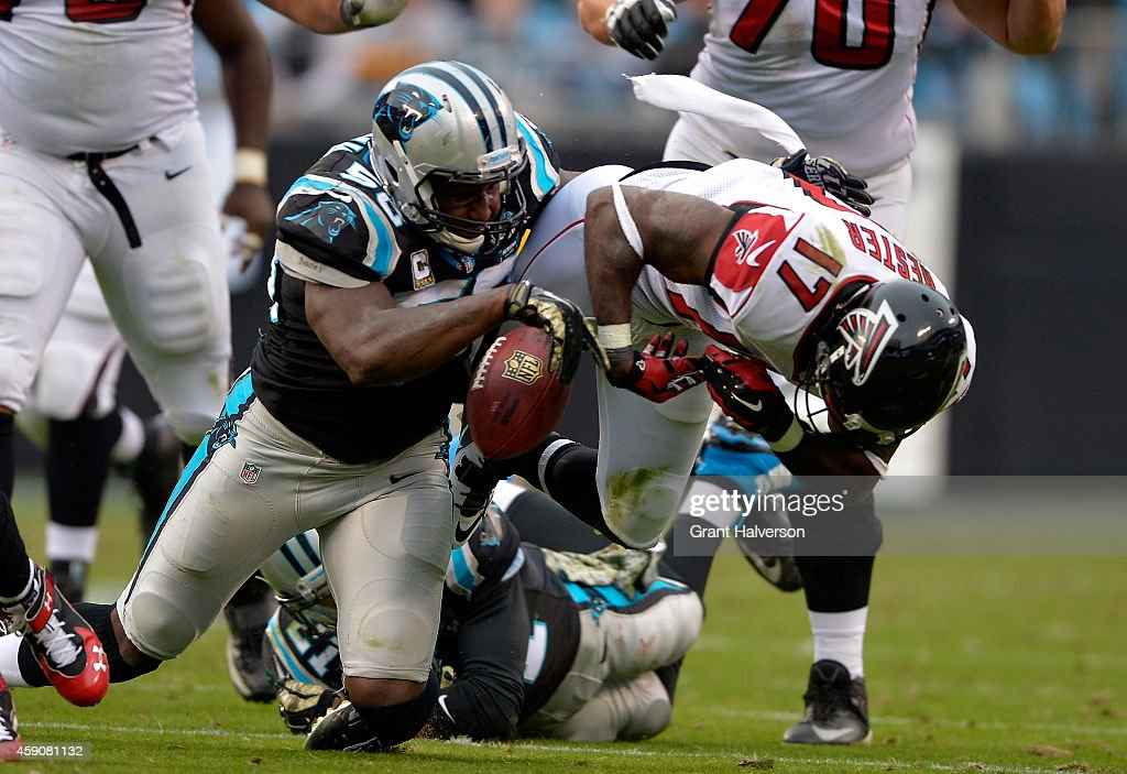 A hit from Thomas Davis of the Carolina Panthers forces a fumble by Devin Hester of the Atlanta Falcons in the 2nd half during their game at Bank of...