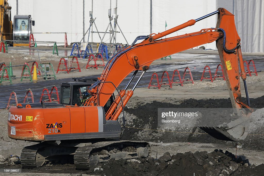 A Hitachi Construction Machinery Co. excavator operates on a construction site in Tokyo, Japan, on Tuesday, Jan. 8, 2013. Prime Minister Shinzo Abe aims to compile Japan's economic stimulus package on Jan. 11, and seeks to have new economic growth strategy by mid-year. Photographer: Kiyoshi Ota/Bloomberg via Getty Images