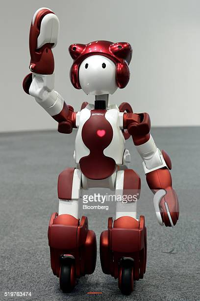 Hitachi Ltd's Emiew3 humanoid robot performs during a demonstration at a media briefing in Tokyo Japan on Friday April 8 2016 The 35 inches robot has...