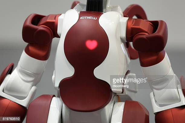 Hitachi Ltd's Emiew3 humanoid robot stands on display at a media briefing in Tokyo Japan on Friday April 8 2016 The 35 inches robot has a remote...
