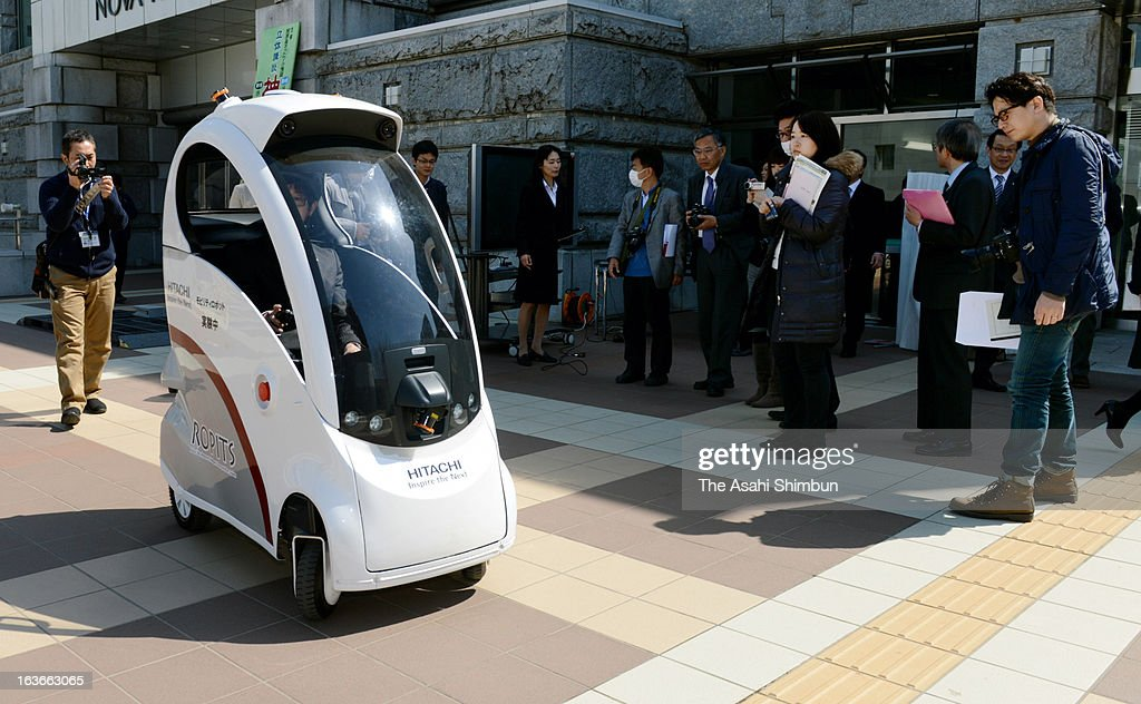 Hitachi unveils its single-seated autonomous vehicle 'Ropits', Robot for Personal Intelligent Transport System, which can be called up to the destination specified on digital tablets on March 12, 2013 in Tsukuba, Ibaraki, Japan.