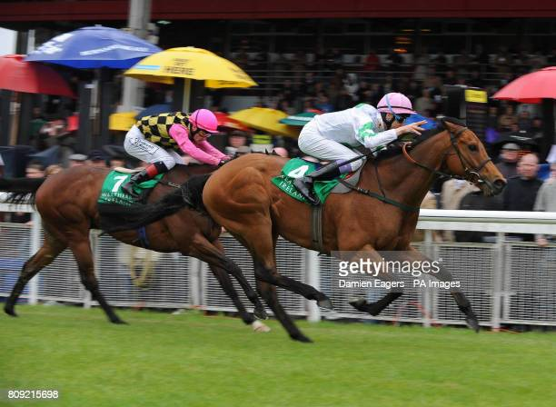 Hitchens with jockey Fran Berry races clear of Tiddlewinks with Pat Smullen on their way to winning the Weatherbys Ireland Greenlands Stakes during...