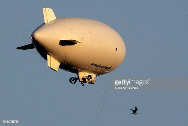 A hitech zeppelin flies over Athens airport during its test flight 23 July 2004 The airship will be flying over Athens during the 1329 August games...