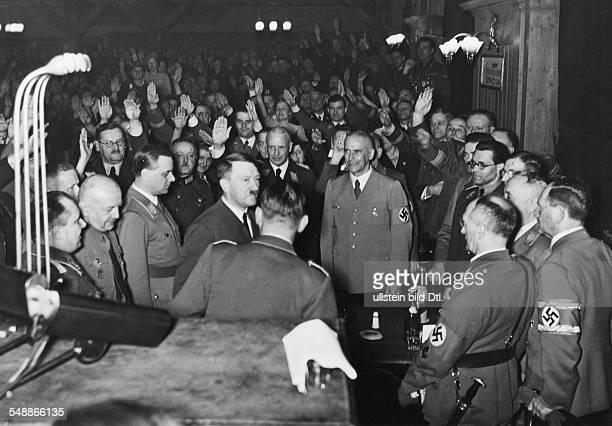 Hitler Adolf Politician NSDAP Germany *20041889 Adolf Hitler arrives at the Hofbraeuhaus in Munich behind Hitler to the left Alfred Rosenberg Adolf...