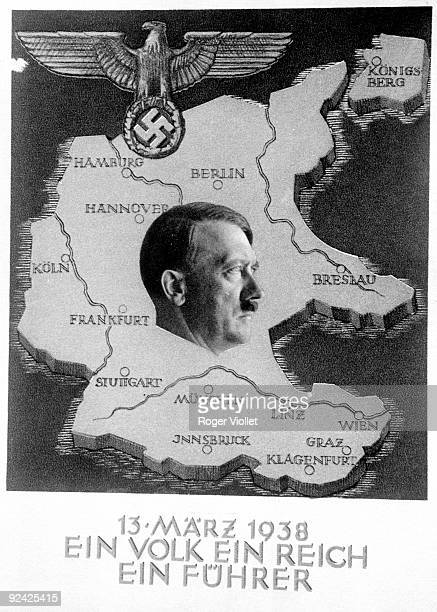 Hitler and the badge of the socialist national party on the map of Germany with the motto 'A People An Empire A Fürher' March 13 1938