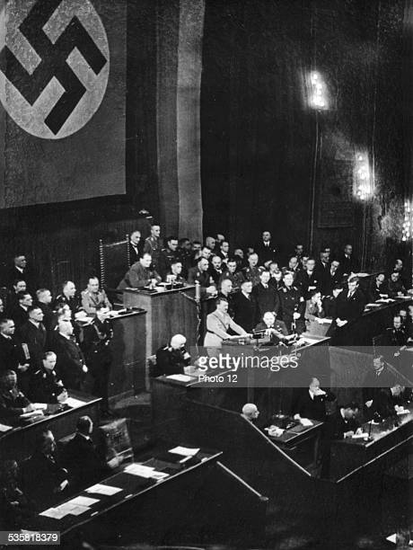 Hitler delivering a speech at the Reichstag 1st anniversary of the National Socialist victory January 30 Germany Paris Bibliothque nationale