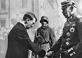 Hitler greets President Hindenburg with a handshake and a deferential bow of the head on 'Potsdam Day' march 21 1933