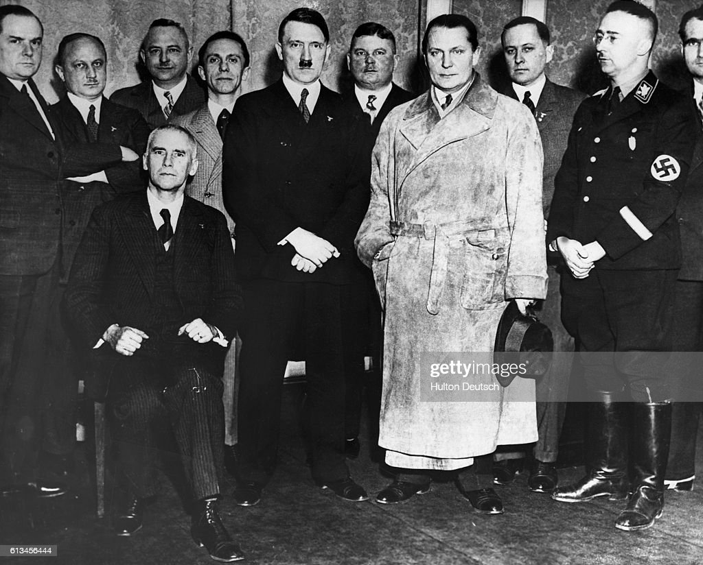 Hitler, newly appointed German Chancellor, stands with senior members of the Nazi party,