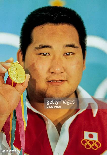 Hitoshi Saito of Japan proudly shows his 95kg gold medal during the press conference on August 10 1984 at the California State University Los Angeles...
