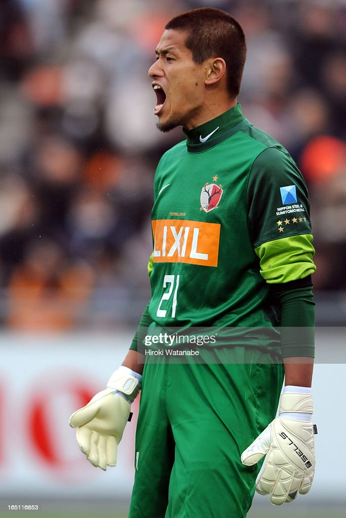 Hitoshi Sogahata of Kashima Antlers in action during the J.League match between Omiya Ardija and Kashiwa Reysol at Nack 5 Stadium Omiya on March 30, 2013 in Saitama, Japan.