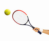 hand holding a tennis racket hitting a ball isolated on white background