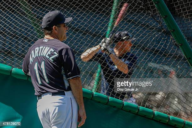 Hitting coach Edgar Martinez of the Seattle Mariners watches Mark Trumbo take early batting practice prior to the game against the Kansas City Royals...