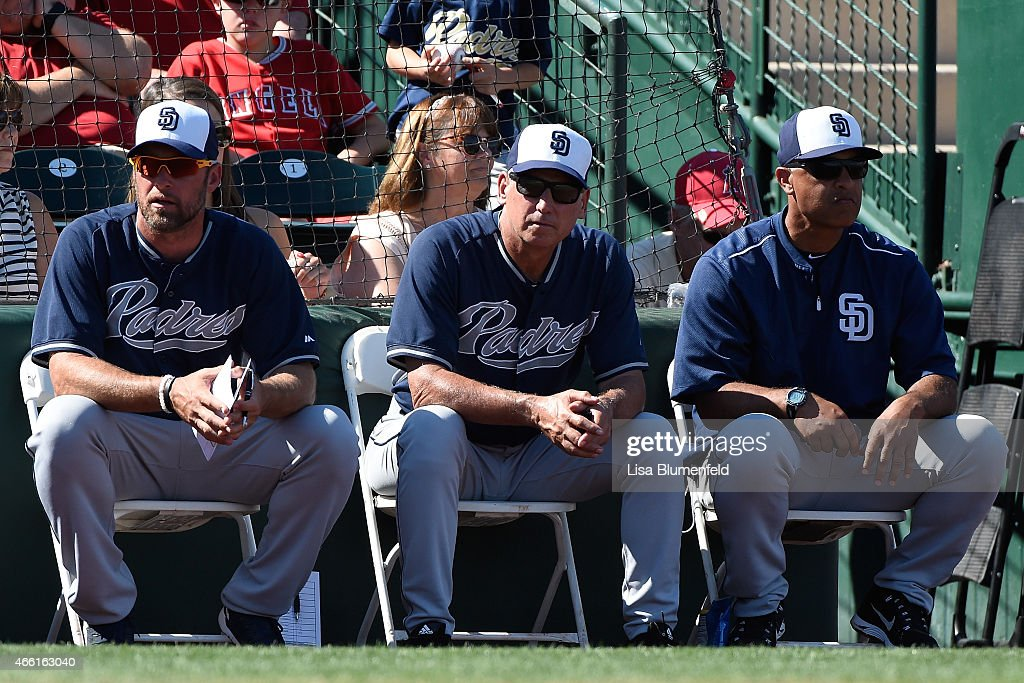 Hitting coach Mark Kotsay manager Bud Black and bench coach Dave Roberts of the San Diego Padres look on during the game against the Los Angeles...