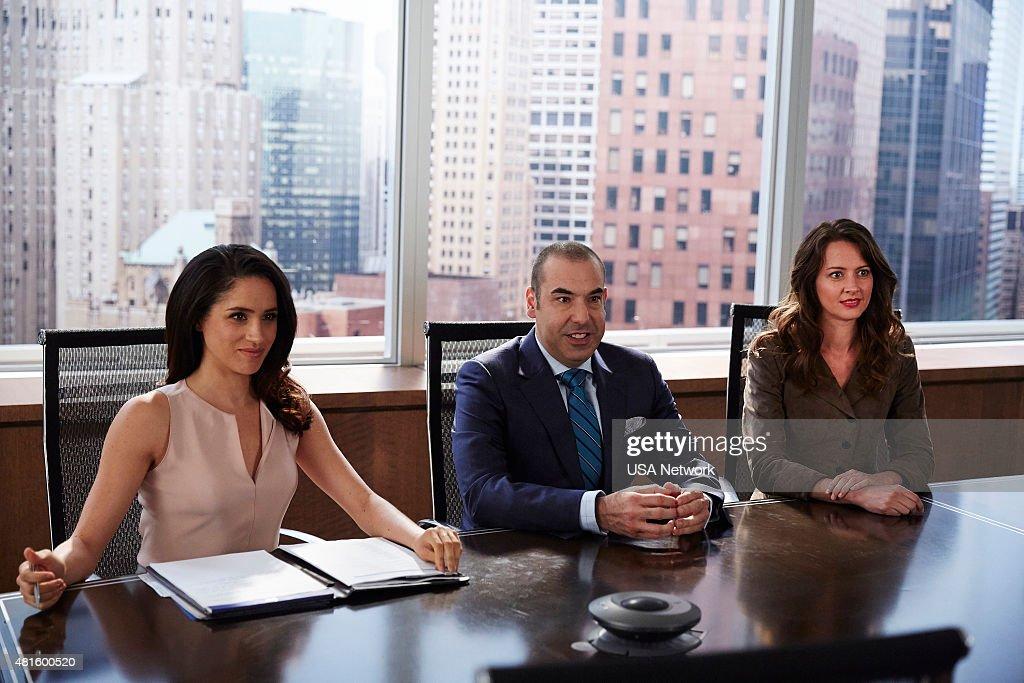 SUITS -- 'Hitting Home' Episode 507 -- Pictured: (l-r) Meghan Markle as Rachel Zane, Rick Hoffman as Louis Litt, Amy Acker as Esther --