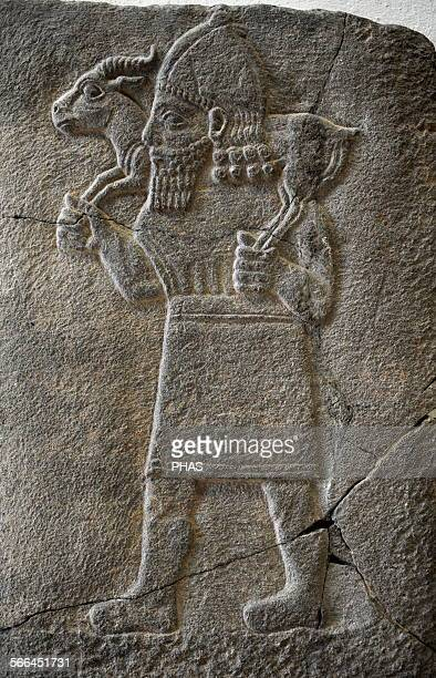 Hittite art Orthostat 8th century BC Relief Man carrying a gazelle Found in old city of Sma'al /Zincirli 775 BC Pergamon Museum Museum Island Berlin...