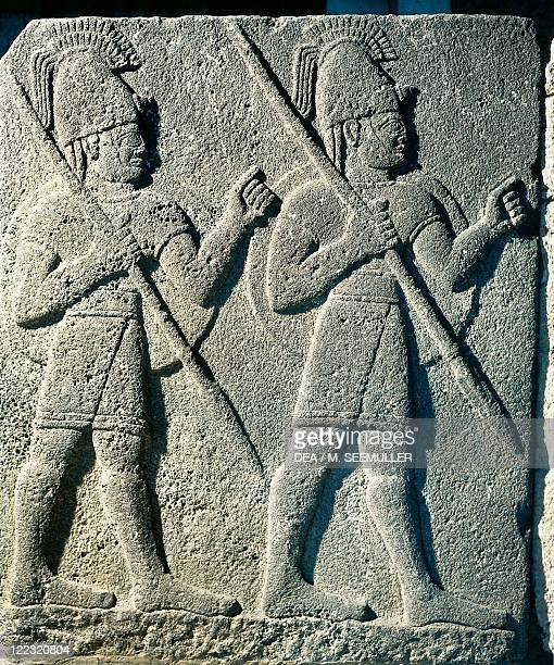 Hittite civilization 9th century bC Basalt slab with relief depicting warriors armed with spear and shield From Carchemish Turkey